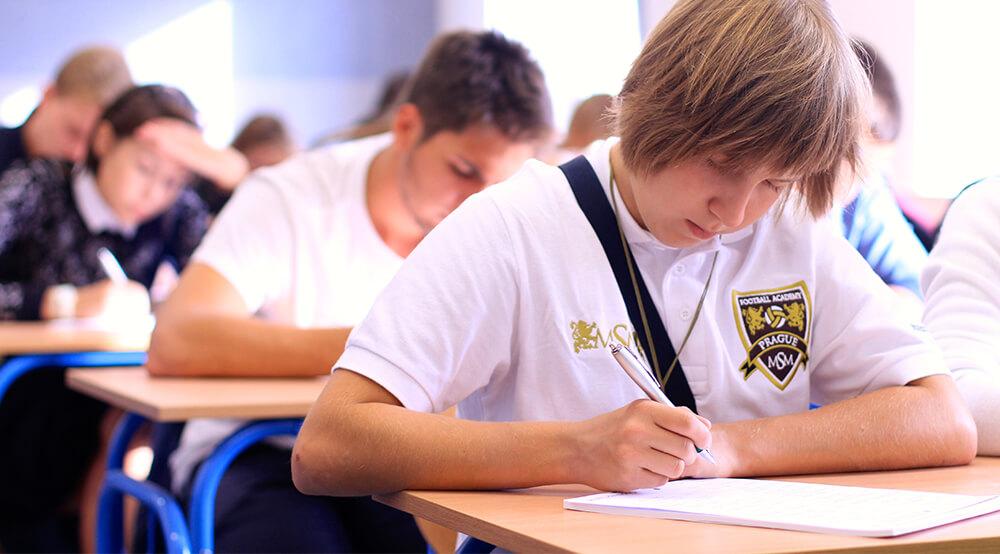 boy is taking an exam msmstudy.eu